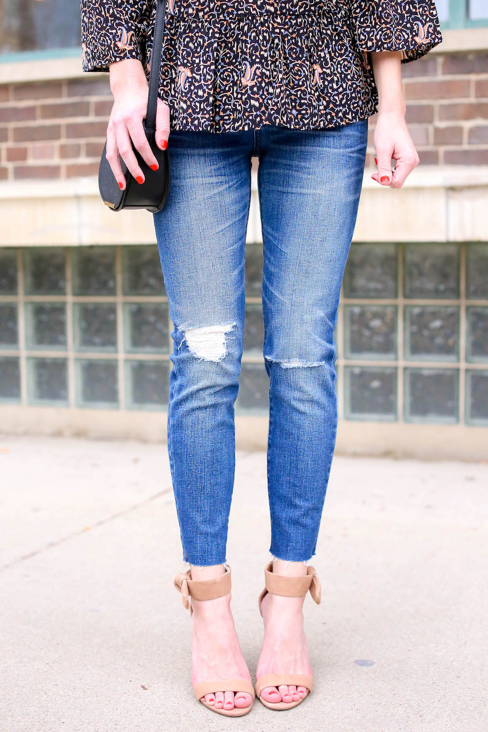 nude heels and distressed denim