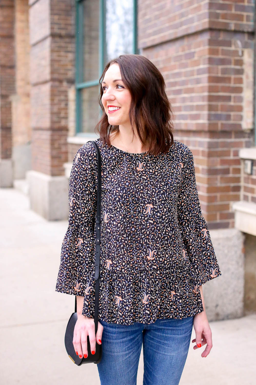 little black bag and floral peplum top