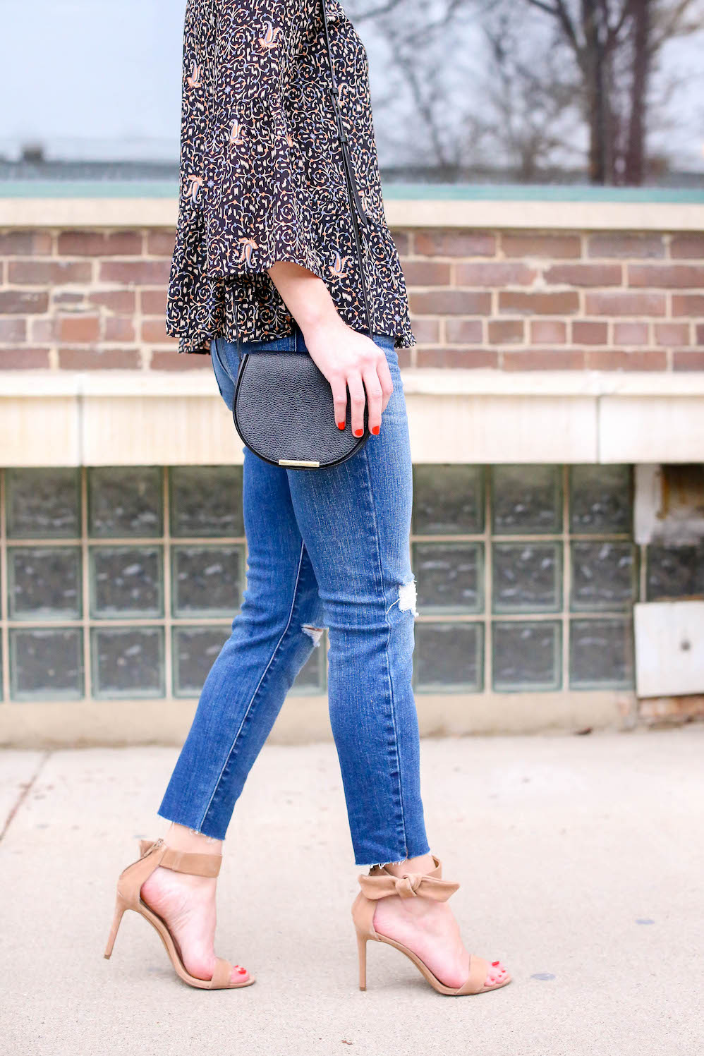 bow heels and distressed jeans