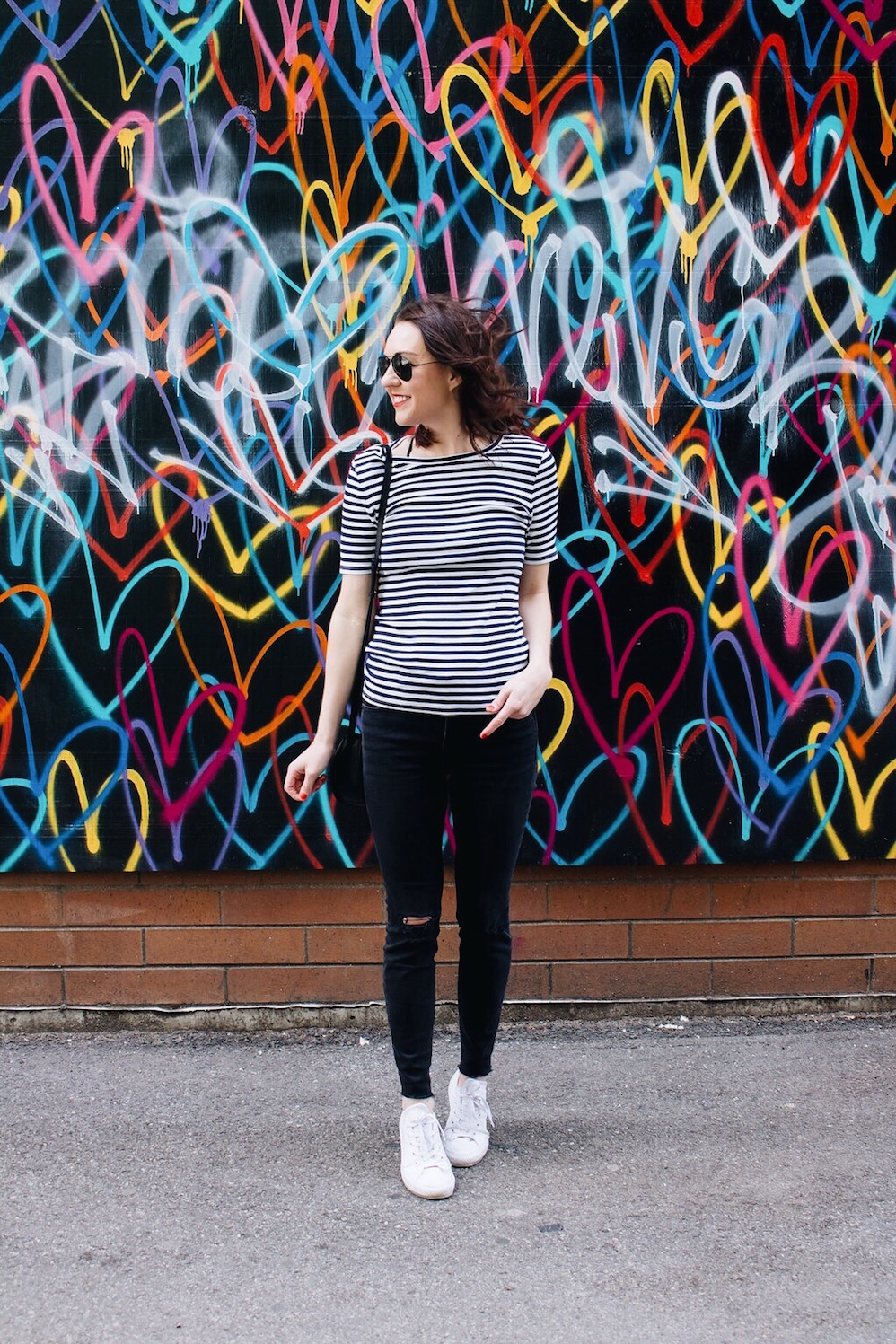 striped shirt and black skinny jeans